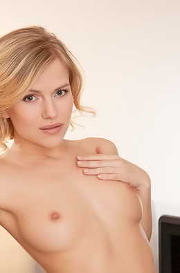Raena - Short haired blonde beauty naked in the office when alone