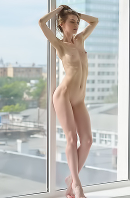 Nude babe at the window