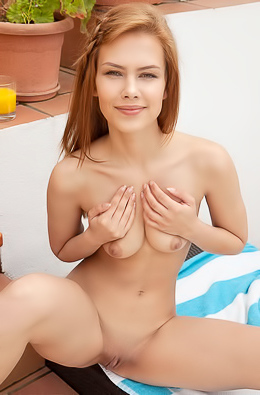Ginger hottie undresses to relax