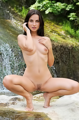 Dark-haired babe orgasms in waterfall