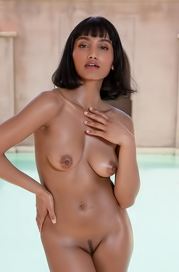 Angel Constance gets naked and hot by the pool